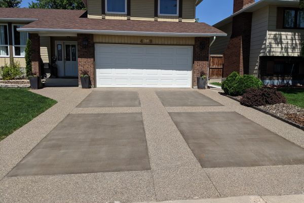 Coloured broomed and exposed driveway