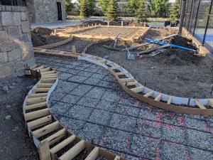 Curved concrete sidewalk border prep
