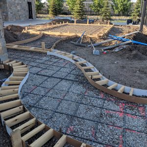 Curved concrete sidewalk border prep