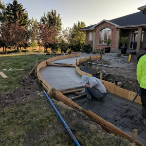 Curved sidewalk and steps pour