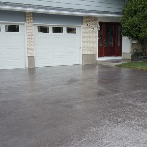 Grey stamped concrete driveway