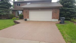 Red/brown exposed aggregate driveway
