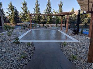 Stamped concrete patio with white concrete