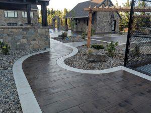 Stamped concrete sidewalk with white concrete