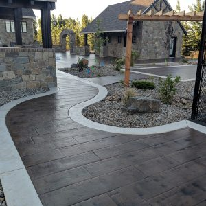 Stamped concrete sidewalk with white concrete
